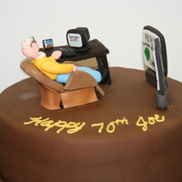 70 Yr Old Man's Birthday Cake A customer ordered a cake for his father-in-law who likes to surf the net and watch his 2 big TV's at the same time while lounging in...