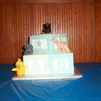 Baby Shower Block Cake  this was for a baby shower bottom tier was a butterscotch cake with maple butterscotch cream cheese filling and the top was a vanilla with...