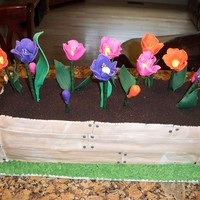 Wooden Flower Box Cake i Made this for my mothers bday, carved into a flower box covered in fondantgumpaste tulips was a spice cake with buttercream filling and...
