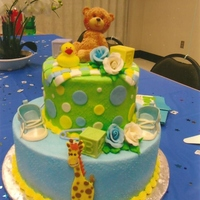Francines Babyshower Cake   Gum paste baby tennis shoes, giraffe and roses. Fondant woven blanket and teddy bear topper.