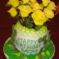 Mom's 70Th 12 MMF yellow roses and leaves with milk chocolate long stems. 100% edible. Had trouble with the vase andthe first two layers crushed under...