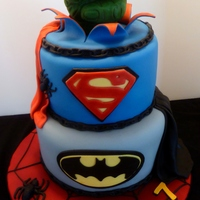 "Superheros Cake A 7th birthday cake made for the son of a friend. The cakes were 9"" and 7"" rounds, covered with MFF. All decorations were..."