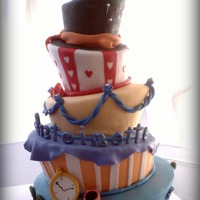 Alice In Wonderland  This is my first attempt at a topsy turvy cake. It was for an Alice in Wonderland themed 18th Birthday Party. 5 tiers red velvet with...