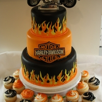 Harley Davidson Cake  This cake was made for a 50th birthday party. The customer provided the bike on top which looks just like his bike. Everything else was...