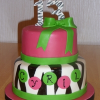 Zebra Stripes I was asked on VERY short notice to create a birthday cake with zebra, hot pink, and lime green. This is what I came up with. TFL!