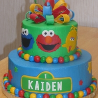 Sesame Street Sesame Street cake for my nephew's first birthday. Buttercream (still working on getting it smooth) with fondant and gumpaste...