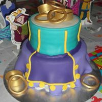 Esmerelda's Dress The client asked for a cake to replicate Esmerelda's dress from the Hunchback of Notre Dam movie. The gold bracelets are made from...