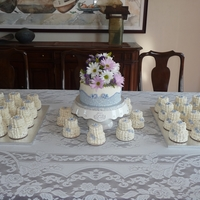 Lavender Bliss Small wedding cake with lace work done in buttercream, fondant flowers & mini wedding cakes also iced in buttercream for the guests....