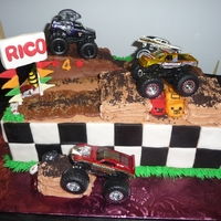 Monster Truck Jam Buttercream iced cake with fondant accents; did for a little boy who loved his monster trucks.