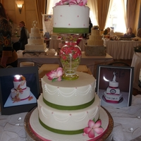 Vase Wedding Cake Fondant covered 3 tier wedding cake using flowered vase to separate & support tiers.