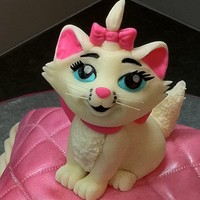 Aristocats Marie This cake was for my buddy's 7 year old daughter Kate. Last year I made her a Minnie Mouse cake. This year she wanted Marie, the white...