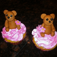 Birthday Cupcakes For Twins pink buttercream, yellow cake, fondant flowers, teddy bear made from gum paste