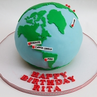 Hiking The World Globe Cake  Made for a 70th Birthday. Vanilla cake with chocolate ganache. Made using the Wilton Sports Ball Pan. All edible decorations. Handcut...