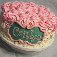 Rosette Cake A dark chocolate cake with raspberry cream filling and IMBC rosettes with pink ombre effect.
