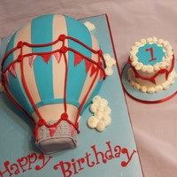 Up, Up, And Away Cake  White Velvet cake with white chocolate IMBC. Original 9x13 cakes carved into hot air balloon. Matching smash cake same flavors as balloon...