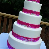 Pink Sequins   Outdoor wedding cake with fondant and pink sequined ribbon