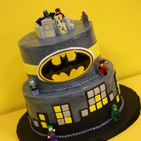 Batman Themed Cake Dark chocolate cake with a cookies and cream IMBC filling on the bottom, topped with white velvet and cheesecake IMBC filling. Buttercream...