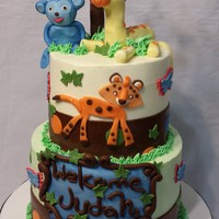 Jungle/safari Cake Candy Clay and fondant mixture was used to create the detail elements on the cake. Animals were created to match the decorations.