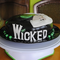 Wicked Birthday Cake White confetti cake with vanilla frosting covered in almond-flavored fondant.