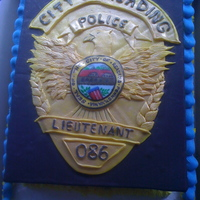 Police Officer Badge - Promotion Cake Fondant police officer's badge, cut and layered then painted with gold dusting powder. The badge was created to be removed from the...