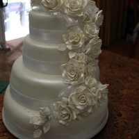 Rose Wedding Cake A four tier Wedding Cake with cascading roses. This is my first ever wedding cake made for a friend.