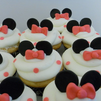 Minnie Mouse Cupcakes Inspired by SO many of the ones I saw on here, these are my own little version. White cake with Vanilla BC. All Satin Ice fondant...
