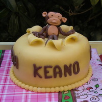 Monkey Birthday Cake  For a little boy who loves monkeys, this birthday cake with monkey topper. Check out the matching cupcakes in my gallerie, for some reason...