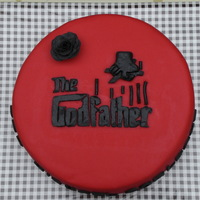 The Godfather Birthday Cake For a young man who just loves the Godfather movies. He wanted just the Godfather logo and the name 'Don Michael Corleone' on the...