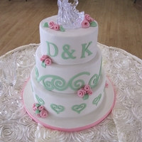 "Debbie & Kevin's Wedding Cake  8"" - Pink Velvet with white chocolate ganache.10"" - Chocolate cake with chocolate ganache.12"" - White Almond Sour Cream cake..."