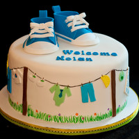 "Converse Baby Shoes And Clothesline Cake   8"" Red Velvet Cake with vanilla buttercream All decorations edible."