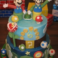 Super Mario fondant and gumpaste decorations on buttercream