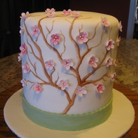 "Cherry Blossom 2- 6"" tiers, top tier is gluten free vanilla cake with smbc, bottom tier is butter vanilla cake with smbc. Branches are painted on..."