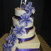 Purple Tiger Lily Cake Gumpaste flowers on SMBC frosting. Cakes are pink lemonade and red velvet. Brides favorite flower is a tiger lily. My only instruction was...