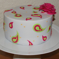 Lime Green And Pink Paisley Chocolate mud cake with chocolate ganache ... and very thin white sugarpaste (as per my Planet Cake book). I like the effect of the sharp...