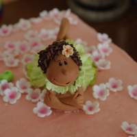 "Fondant Flower Girl Cake Topper A handmade topper on a buttercream cake. My 3rd ""human"" figure - the first made in a class that I took with Gracescakes here in..."