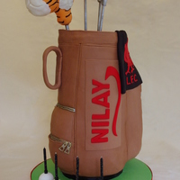 "Golf Bag Cake 4x 6 inch cake stack covered in Jennifer Dontz's chocolate fondant with RKT ""padding"" for pockets. The golf club heads are..."