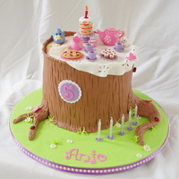 Anjo's Forest Tea Party Cake   Fondant tea set toppers with extended tier tree stump cake covered in fondant.