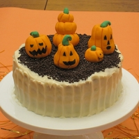 Jack Patch Pumpkin cake with mini jack o lanterns made with fondant