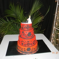 First Wedding Cake white cake buttercream frosting fondant accents red orange color