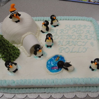 Penguins Cake was made for my friends at the zoo. White chocolate buttercream and marshmellow fondant used for igloo and penguins. It was a big hit...