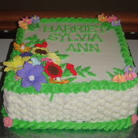 "Spring Flowers On Basket Weave This is a 10"" square double layer, with butter cream frosting andgum paste flowers. The cake ended up being about 5"" high so..."