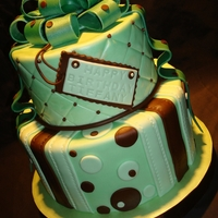 Green And Brown With Bow White cake with lemon and whipped white chocolate ganache filling