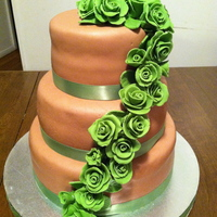 Rose Wedding Cake This was a chocolate fondant wedding cake with green roses.