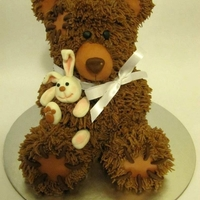 Cute Teddybear :-) Teddybear cake, too cute! Everyone wanted to cuddle it, not eat it! This consists of 6 chocolate cakes, decorated with chocolate swiss...