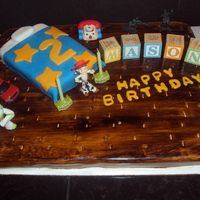 "Toy Story Cake This was for my sons 2nd birthday. he loves Toy Story, so i made ""Mason's Room"". the floor and bed are cake, strawberry w/..."