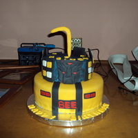 Transformers Cake Vanilla cakes with vanilla BC. Fondant was colored by me.