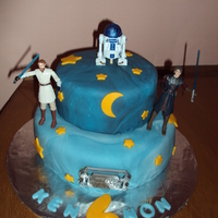 Star Wars vanilla cake w/ vanilla bc. covered in marbled fondant. stars and moon are colored fondant. toppers are toys
