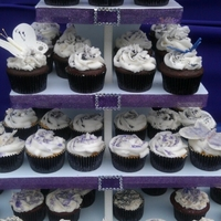 Graduation Butterfly Cupcakes Cupcake flavors were vanilla, chocolate and red velvet. Iced i buttercream and cream cheese frosting. Topped with silver, purple and black...
