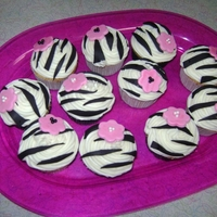 Zebra Cupcakes  I made these for my daughter's 7th birthday. She is obsessed with zebra and pink right now. Stripes and flowers were made out of...