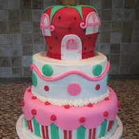Strawberry Shortcake   2 tier cake with buttercream icing and fondant accents. The strawberry on top is RKT, iced and decorated with fondant.